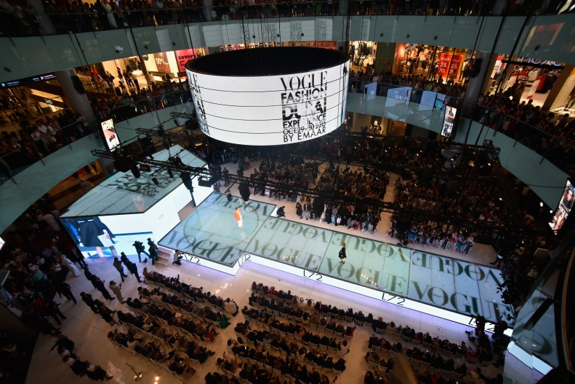 DUBAI, UNITED ARAB EMIRATES - OCTOBER 29:  Models walk the runway at the Talents Fashion show during the Vogue Fashion Dubai Experience 2015 at The Dubai Mall on October 29, 2015 in Dubai, United Arab Emirates.  (Photo by Cedric Ribeiro/Getty Images for Vogue and The Dubai Mall)