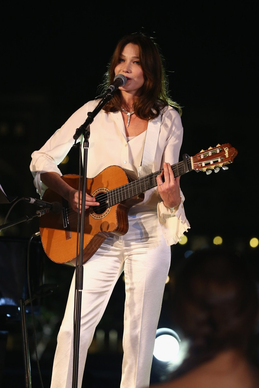 DUBAI, UNITED ARAB EMIRATES - OCTOBER 30:  Carla Bruni performs live at the Gala event during the Vogue Fashion Dubai Experience 2015 at Armani Hotel Dubai on October 30, 2015 in Dubai, United Arab Emirates.  (Photo by Andreas Rentz/Getty Images for Vogue and The Dubai Mall) *** Local Caption *** Carla Bruni